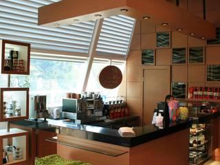 Treviolo Café - JF: Espaços gastronômicos  por Camila Tiveron Arquitetura
