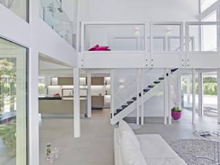 Wellness house near Bremen Modern living room by DAVINCI HAUS GmbH & Co. KG Modern