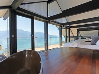 Haus am Hang in Genf am See - CH Moderne Schlafzimmer von DAVINCI HAUS GmbH & Co. KG Modern