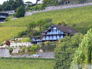 Haus am Hang in Genf am See - CH Moderne Häuser von DAVINCI HAUS GmbH & Co. KG Modern