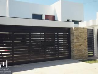Vivienda NC: Casas unifamiliares de estilo  por Estudio A+I,Moderno