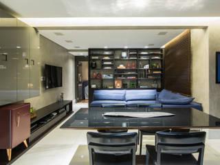 Apartamento Vila da Serra: Salas de estar  por Ana Mendes Arquitetura
