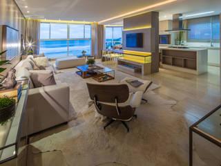 Projeto de interiores cria ambiente clean e contemporâneo na praia: Salas de estar  por PROCAVE,Moderno