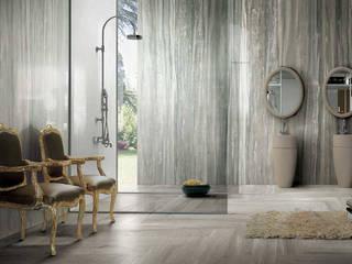 Revestimentos Cerâmicos: Casas de banho  por Stoneceramic, Lda