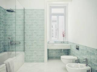 Santa Justa 60 - Stone Capital Casas de banho modernas por Onstudio Lda Moderno