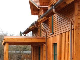 SCHOß INGENIEUR GmbH Casas de estilo rústico