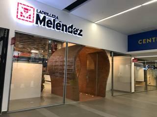 Local Ladrillera Melendez: Oficinas y Tiendas de estilo  por EXPERIMENTAL ARQUITECTOS S.A.S
