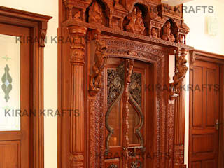 Carved Pooja Door:  Wooden doors by Kiran Enterprises