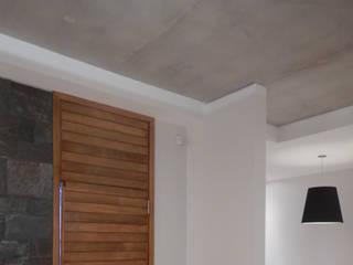 Casa M-25: Pasillos y recibidores de estilo  por Estudio D3B Arquitectos