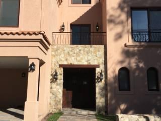 CASAEN SAINT THOMAS CC: Casas unifamiliares de estilo  por Estudio Dillon Terzaghi Arquitectura