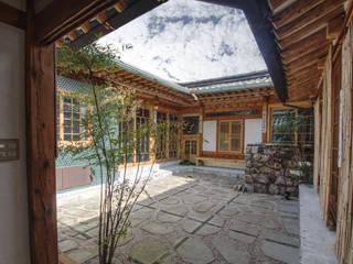 Jardines de estilo asiático de 참우리건축 Asiático