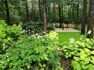 Ogród w lesie Magdalenka Warszawa od GRINER Architektura Krajobrazu