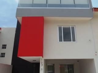 "Casa ""Punto Rojo"":  de estilo  por T+E ARQUITECTOS"