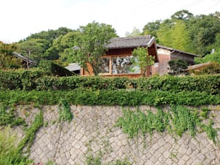 Rumah kayu oleh 丸菱建築計画事務所 MALUBISHI ARCHITECTS, Modern