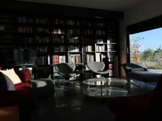 Vivienda Guadiana Golf Salones de estilo moderno de DonStudio Moderno