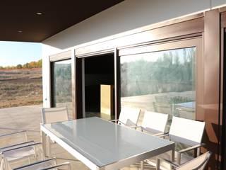 Vivienda Guadiana Golf DonStudio Balcones y terrazas de estilo moderno