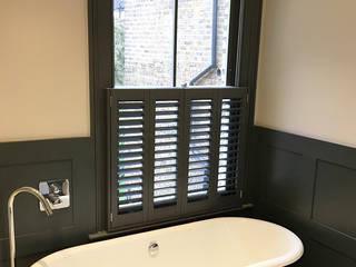 Something Personal in a Fulham Home Plantation Shutters Ltd BathroomFittings Kayu Green