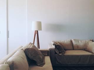 Apartamento M1401: Salas de estar  por Eduardo Piovesan / Arquitetura,Moderno