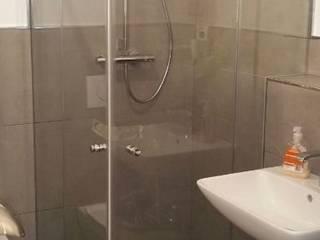 Duschkabinen nach Maß Komandor Essen:  Badezimmer von Komandor Essen Schiebetüren Studio Jarosch Siegfried