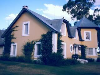 CASA DE CAMPO: Casas de campo de estilo  por Estudio Dillon Terzaghi Arquitectura