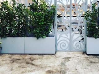 Balcones y terrazas eclécticos de Au dehors Studio. Architettura del Paesaggio Ecléctico