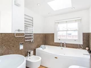 My First House:  Bathroom by John Doe Architects