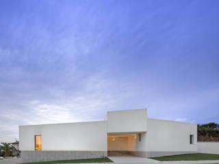 Casa Brunhais: Moradias  por Rui Vieira Oliveira Arquitecto
