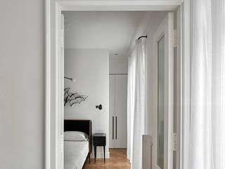 Camera da letto in stile  di DG Arquitecto Valencia
