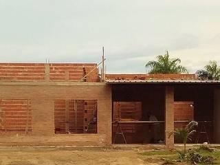 Construcción : Casas de estilo  por M2 Arquitectura