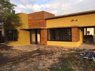 Participación en un proyecto de vivienda unifamiliar: Casas unifamiliares de estilo  por M2 Arquitectura