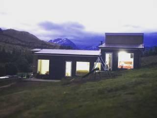 Fachada Oriente: Casas unifamiliares de estilo  por casa rural