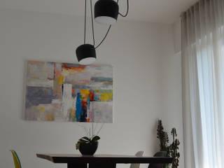 Foto soggiorno_area pranzo: Sala da pranzo in stile in stile Moderno di IDEASTUDIO