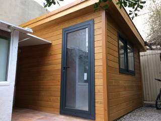 Caseta de madera habitable oficina : Estudios y despachos de estilo  de Grupo Dancu 2017 S.L