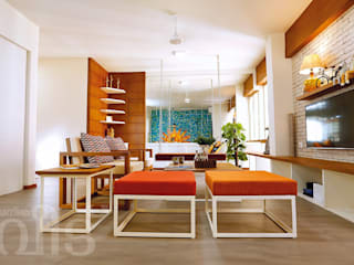 The Rising Sun Apartment:  Living room by S Squared Architects Pvt Ltd.