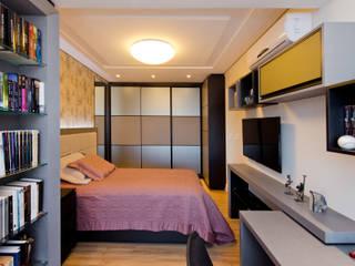 O desfio de transformar 2 apartamentos em 1   : Quartos  por +2 Arquitetura,