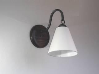 Serie de lamparas de brazo colgante:  de estilo  por Hierro Arte Iluminación EIRL