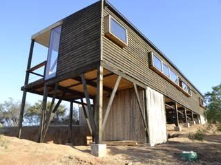 Vista poniente: Casas de estilo  por PhilippeGameArquitectos