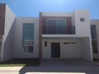 FACHADA PRINCIPAL: Casas unifamiliares de estilo  por Goytia Ingenieria
