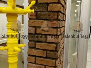 İSTANBUL TAŞÇI ® – Mağaza İç Dekorasyon Kolon Tuğla Uygulaması: modern tarz , Modern