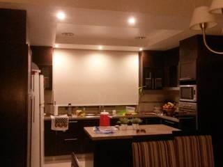 VIVIENDA SN: Cocinas a medida  de estilo  por BVS+GN ARQUITECTURA,Moderno