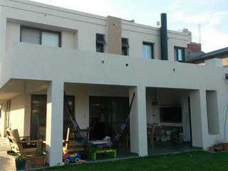 VIVIENDA PR: Casas unifamiliares de estilo  por BVS+GN ARQUITECTURA,Moderno