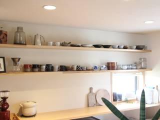 屋根裏工房~家族が喜ぶ趣味の家~: 株式会社 山弘が手掛けたキッチンです。