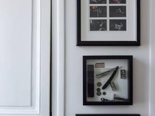 Un appartement à l'esprit vintage: Salle de bains de style  par Eclectiko Studio