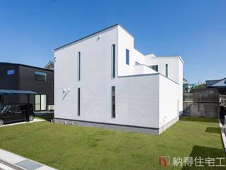 Asian style houses by 納得住宅工房株式会社 Nattoku Jutaku Kobo.,Co.Ltd. Asian