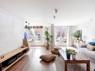 Reforma y Amueblamiento en sótano de vivienda unifamiliar adosada en Tres Cantos Salones rústicos de estilo rústico de itta estudio Rústico