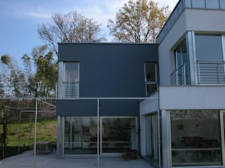 Modern houses by Enzo Cantoni Architetto Modern