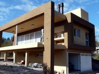 Maisons de style  par muñoz bunteh arquitectos,