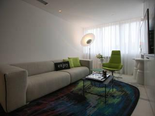 Apartamento Figueira da Foz: Salas de estar  por Tralhão Design Center,Moderno