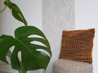 Un aménagement doux et chaleureux pour un jeune couple: Salon de style  par CS Architecture d'intérieur
