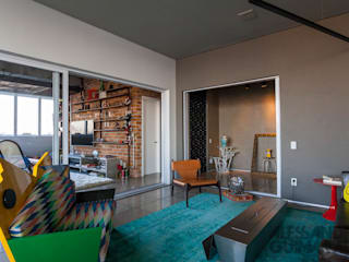 Salas de estilo industrial por Nautilo Arquitetura & Gerenciamento
